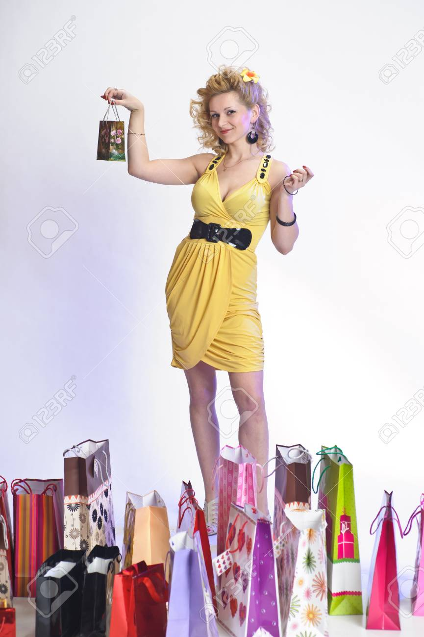 young woman with lots of shopping Stock Photo - 10509843