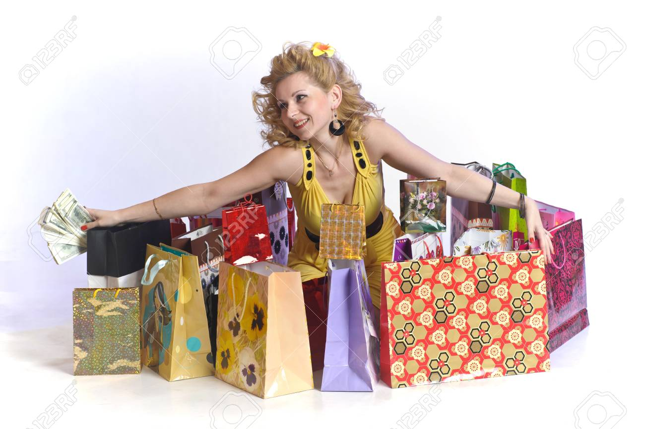 young woman with shopping and money Stock Photo - 10509885