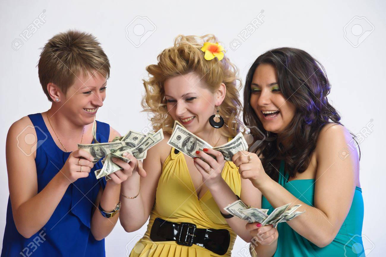 girls with money  in their hands Stock Photo - 10584448