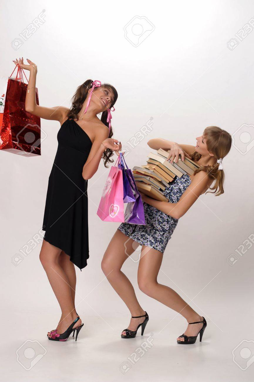 Shopping girl and a student with books Stock Photo - 10077529