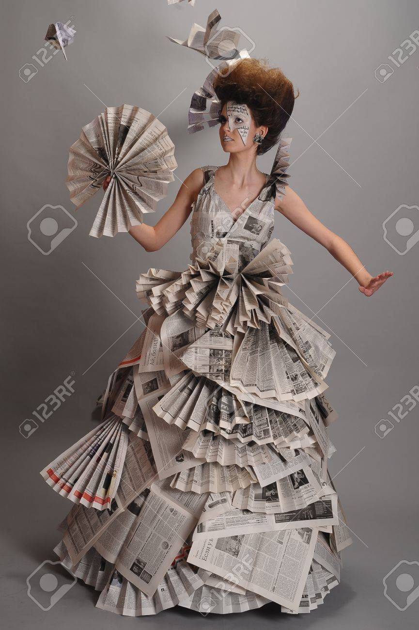 Portrait of a beautiful girl in a newspaper dress Stock Photo - 9669459