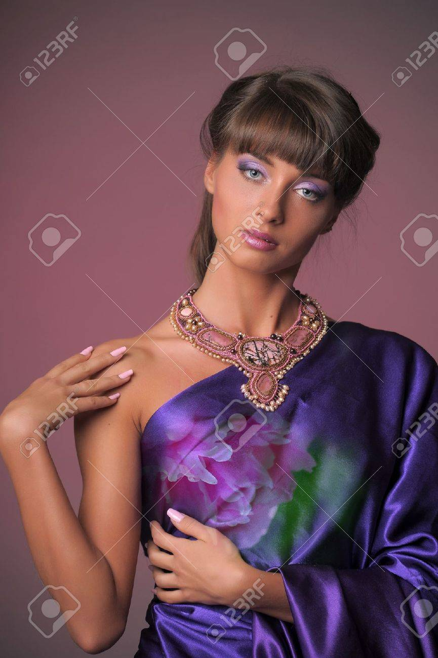 The elegant girl in the lilac Stock Photo - 11057338