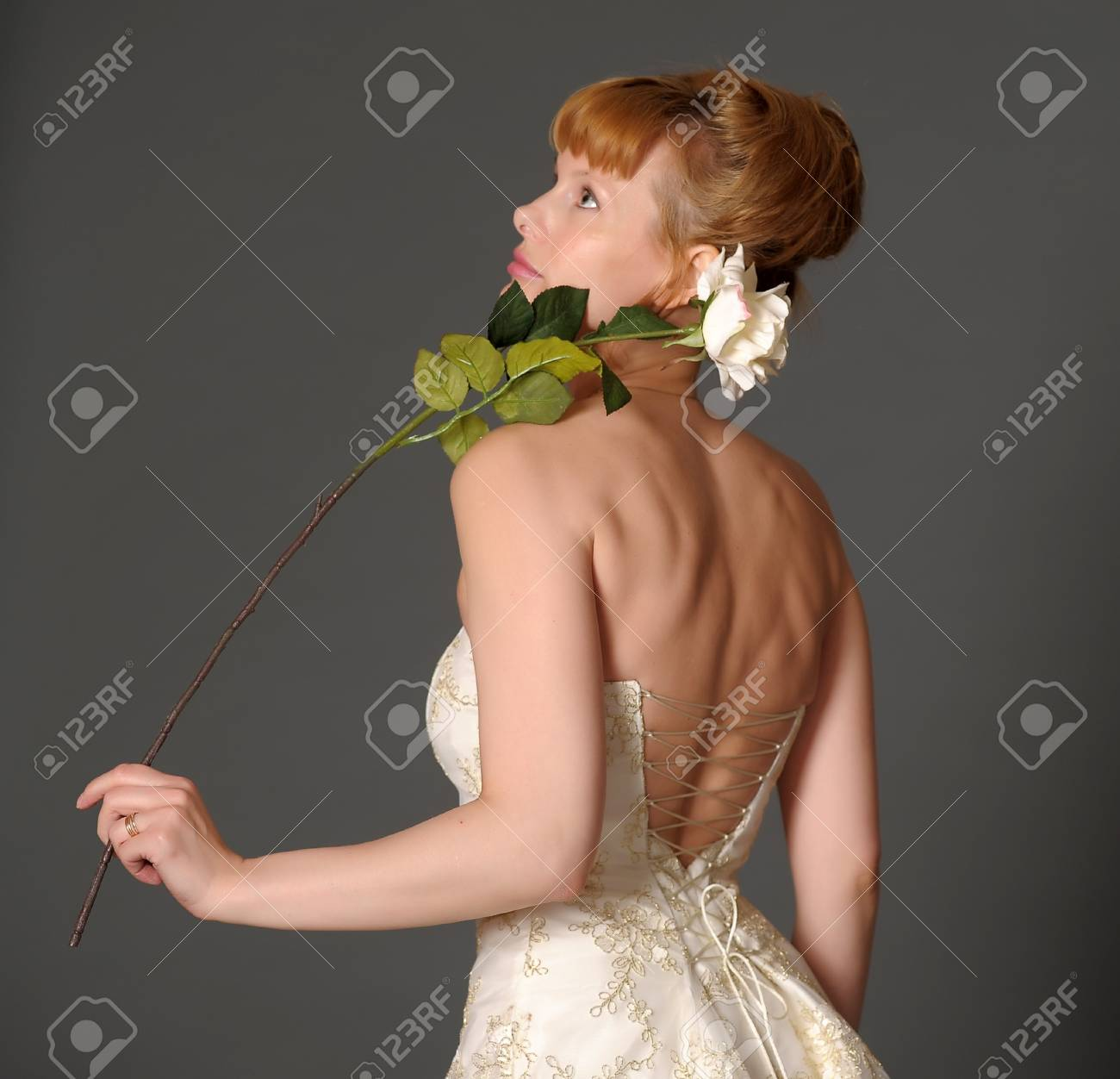 woman in a wedding dress on a gray background Stock Photo - 9729754