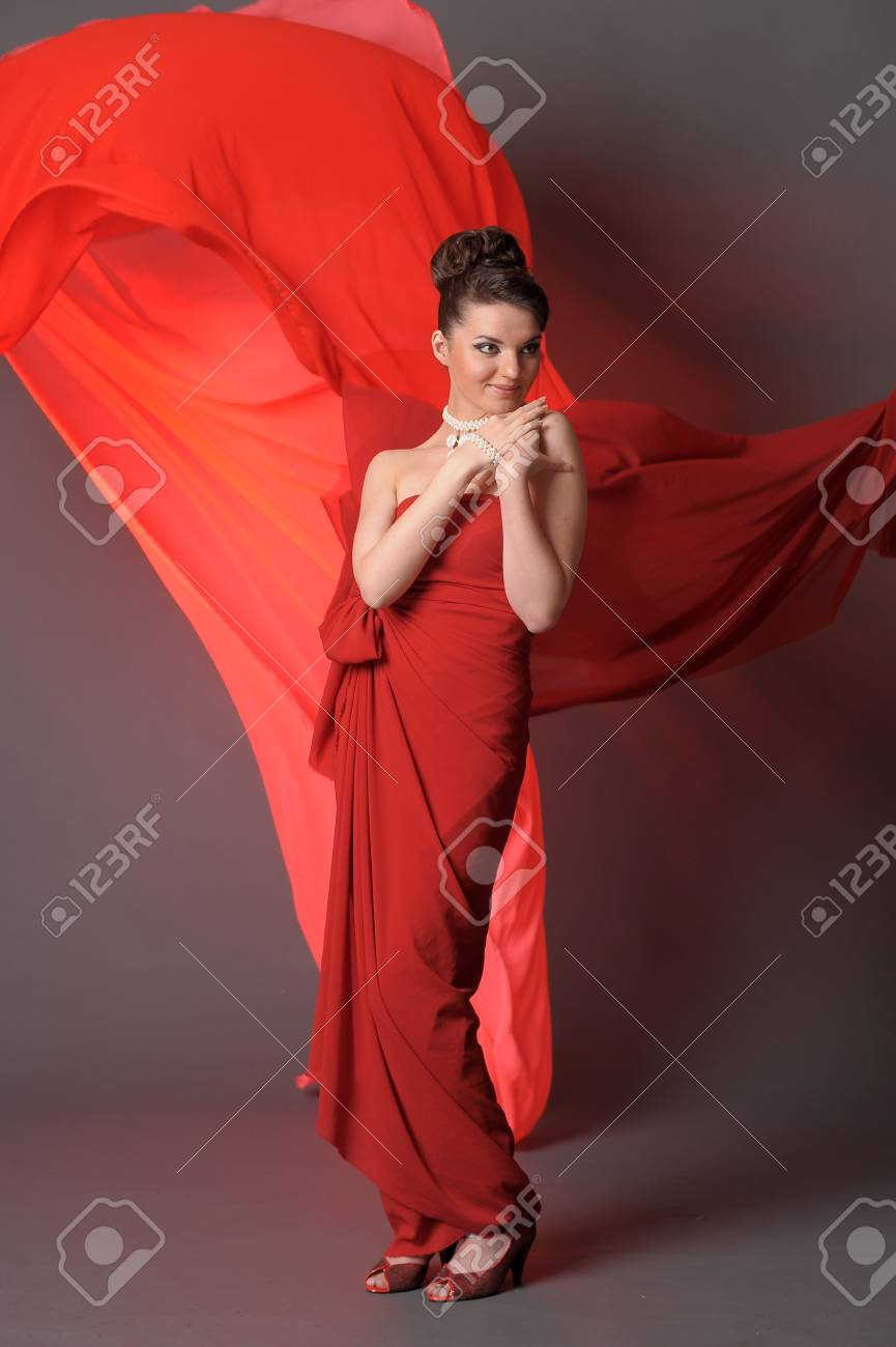 The beautiful girl in a long red dress Stock Photo - 11422325