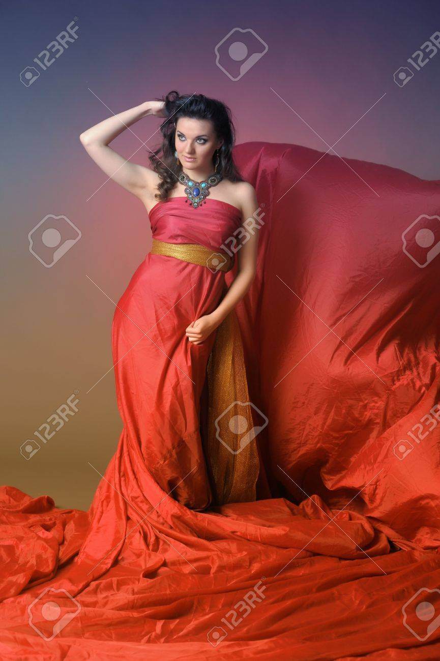 The beautiful girl in a long red dress Stock Photo - 11422343