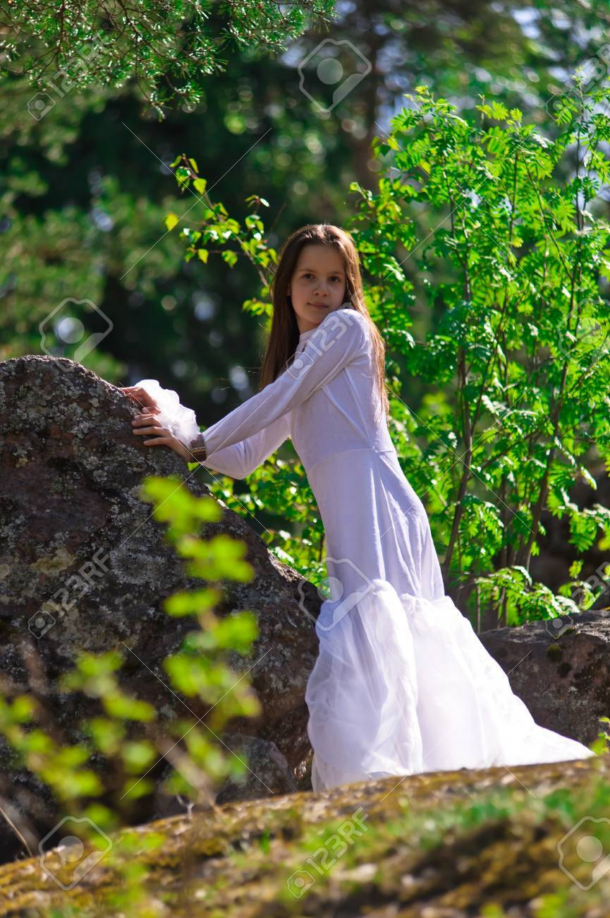 girl in white dress in the woods Stock Photo - 10324631