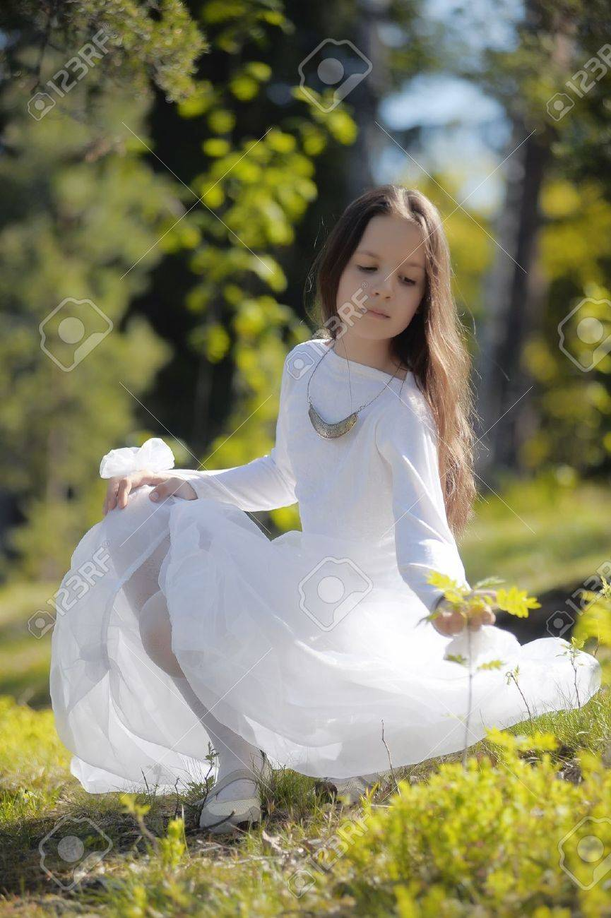 girl in white dress in the woods Stock Photo - 10324619