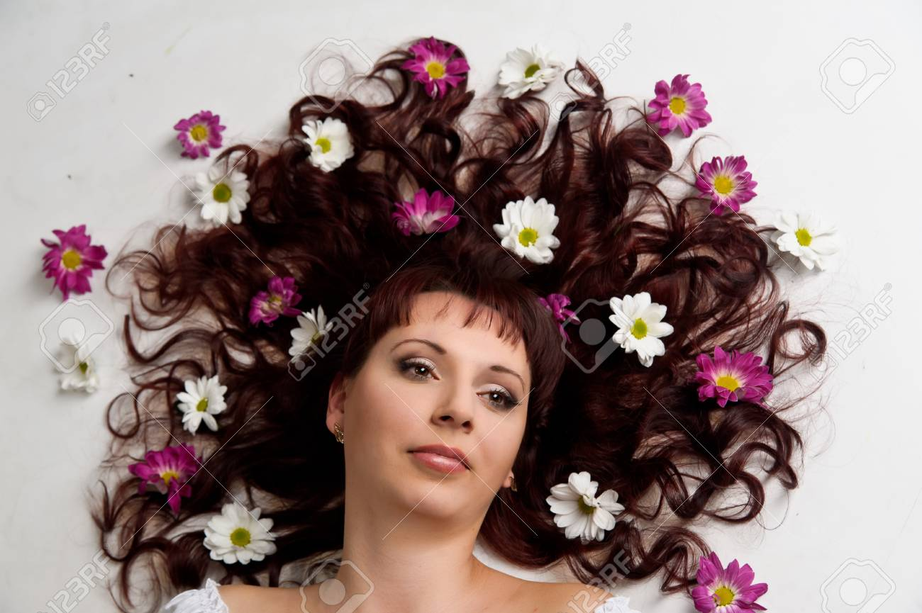 woman with flowers in her hair Stock Photo - 10221788