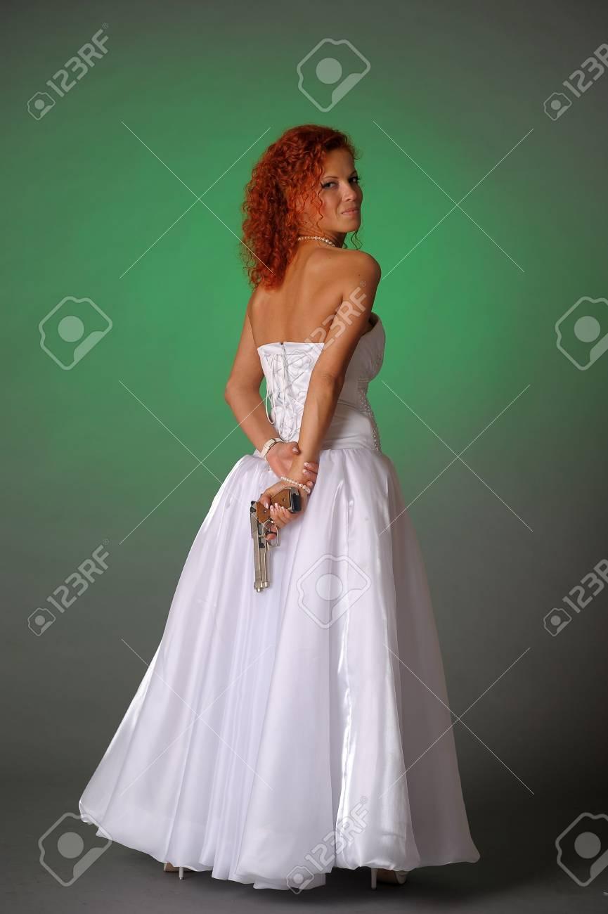 beautiful bride with a gun Stock Photo - 10566543