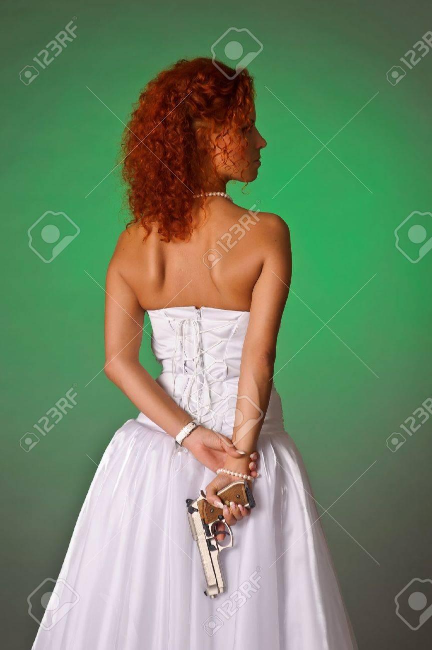 beautiful bride with a gun Stock Photo - 10566589