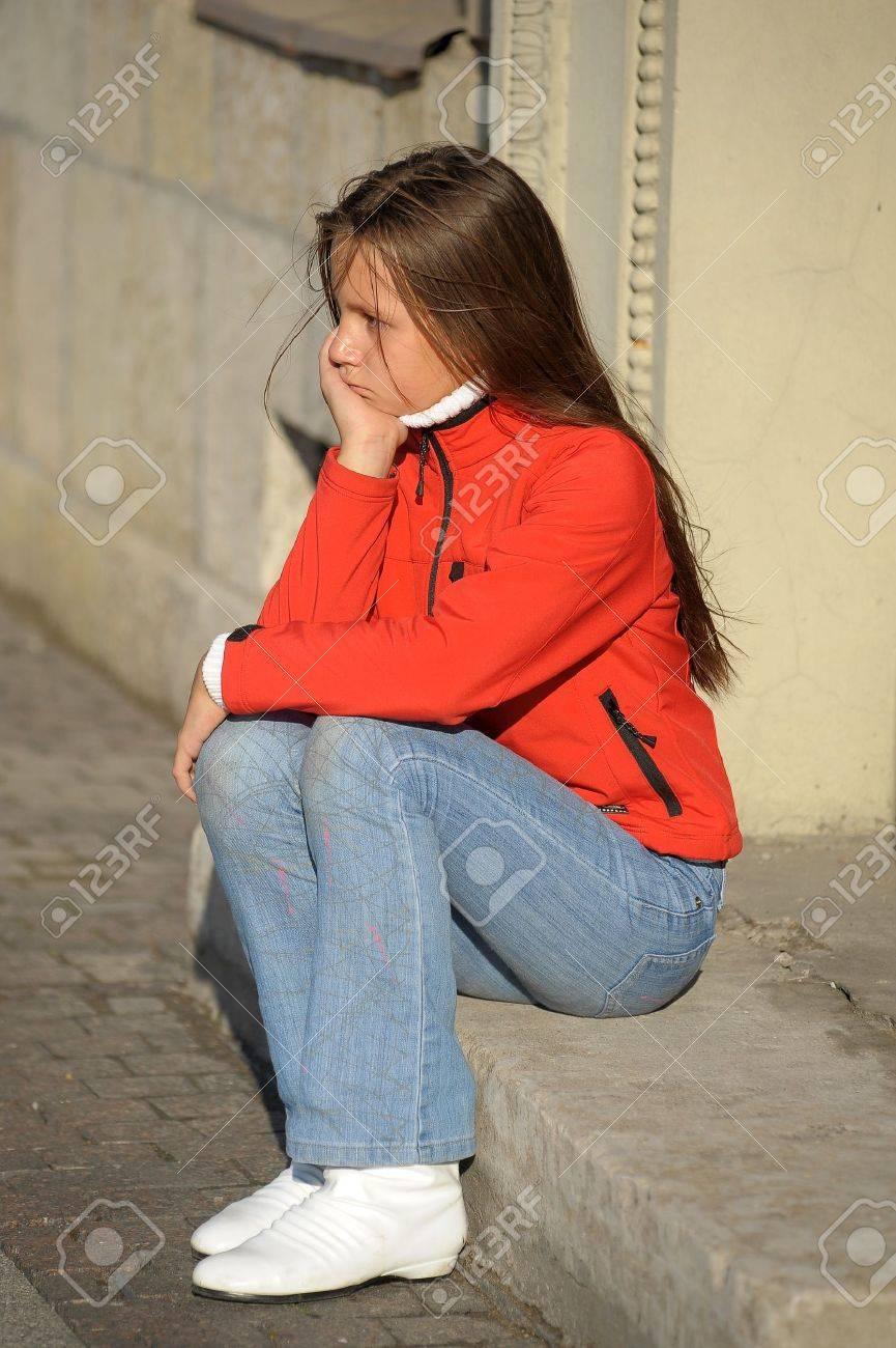 sad girl sitting on the doorstep Stock Photo - 10578259