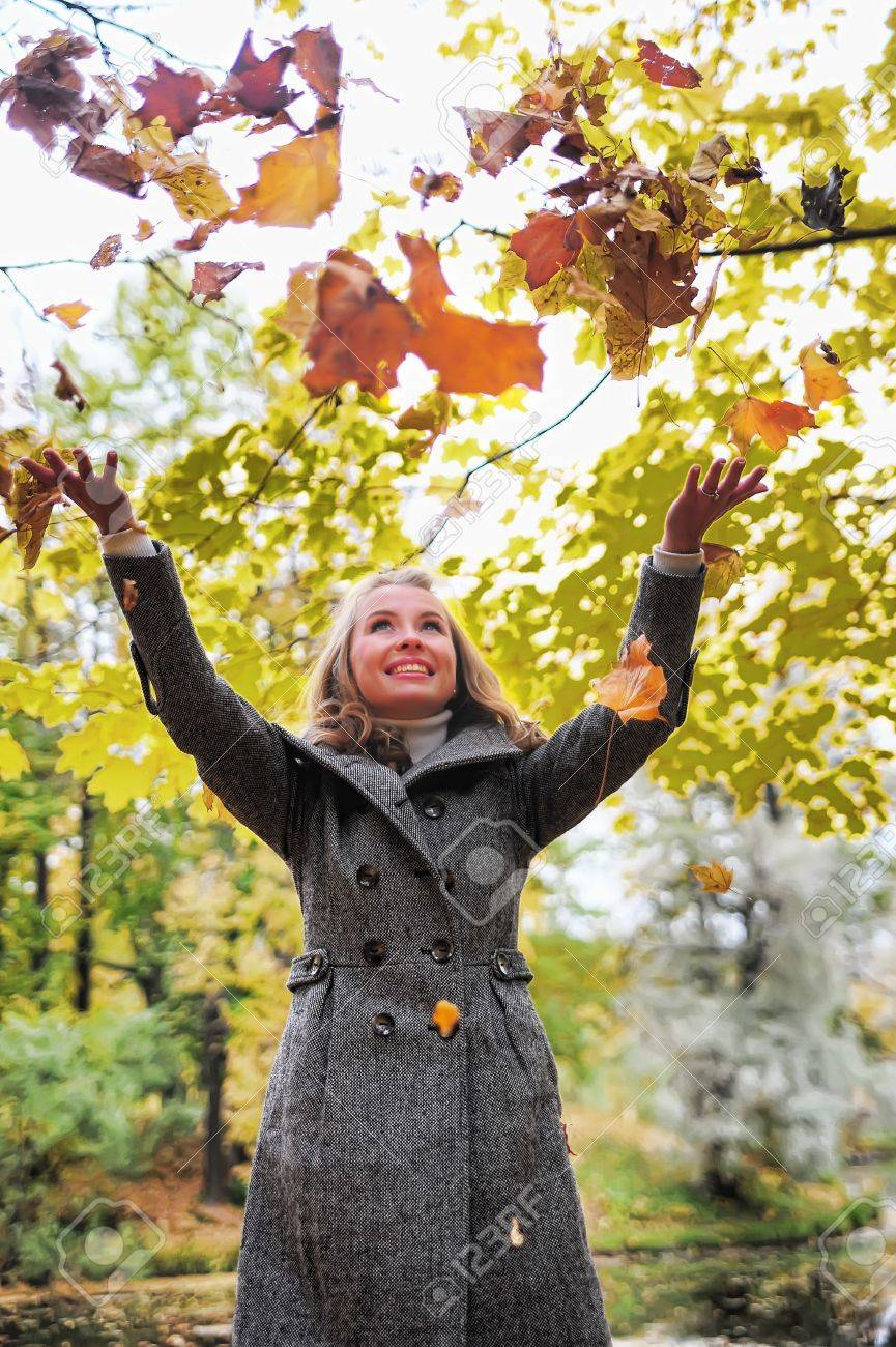 Girl throwing leaves Stock Photo - 10604143