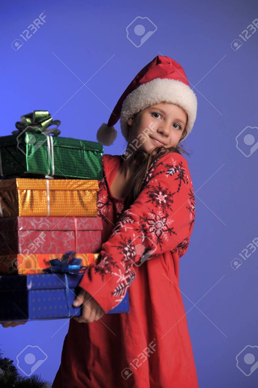 Girl teenager in santa hat with Christmas gifts Stock Photo - 10701188