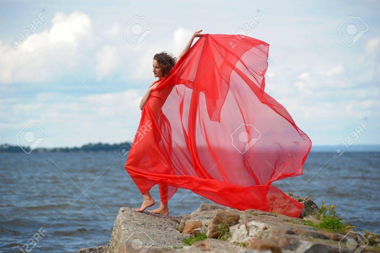Beautiful hippie girl with red fabric Stock Photo - 13384193
