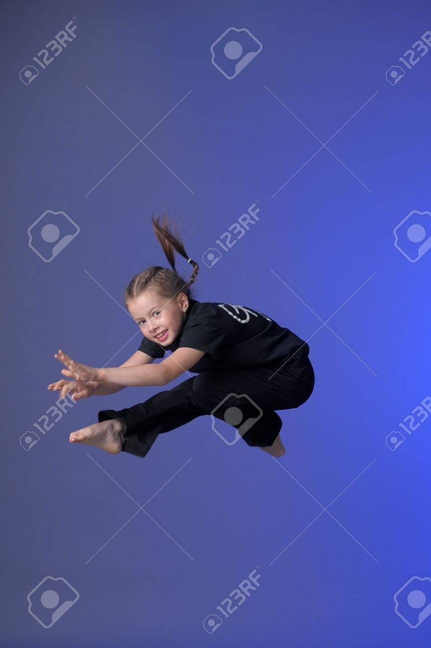 Gymnast girl jumping studio Stock Photo - 11573925