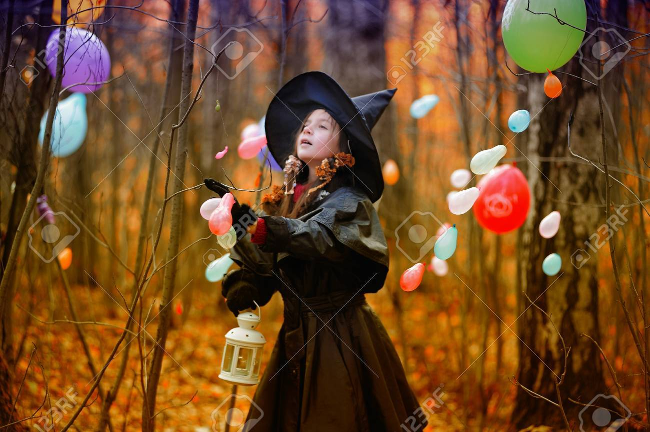 Small Girl In A Witch Halloween Costume Stock Photo, Picture And ...