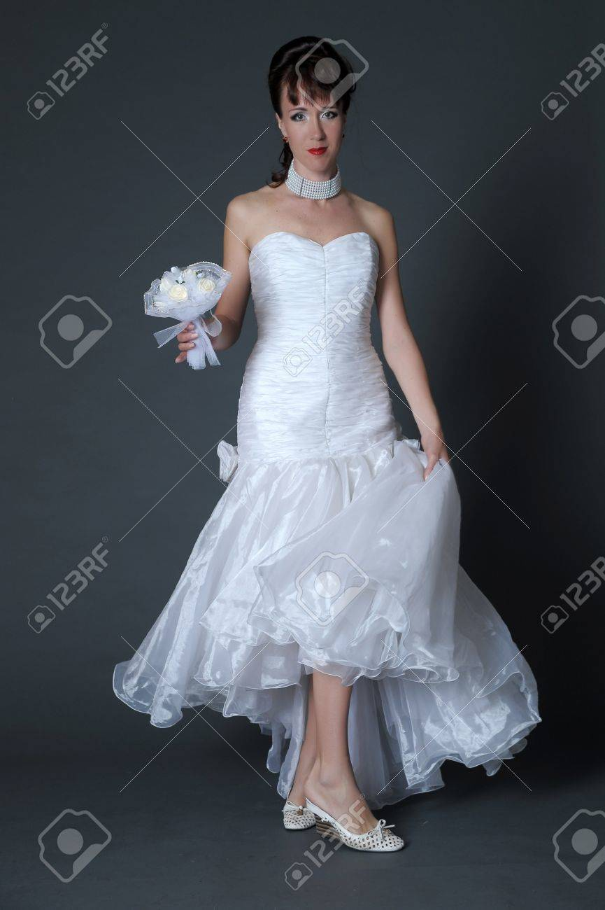 The happy bride with a white rose Stock Photo - 11038832