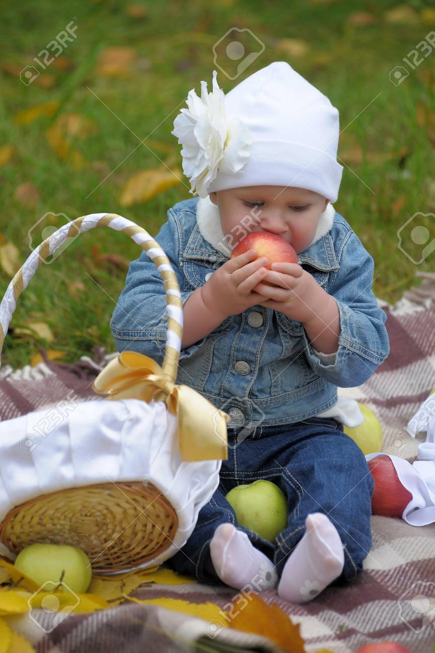 The little girl with a basket of apples Stock Photo - 11037135