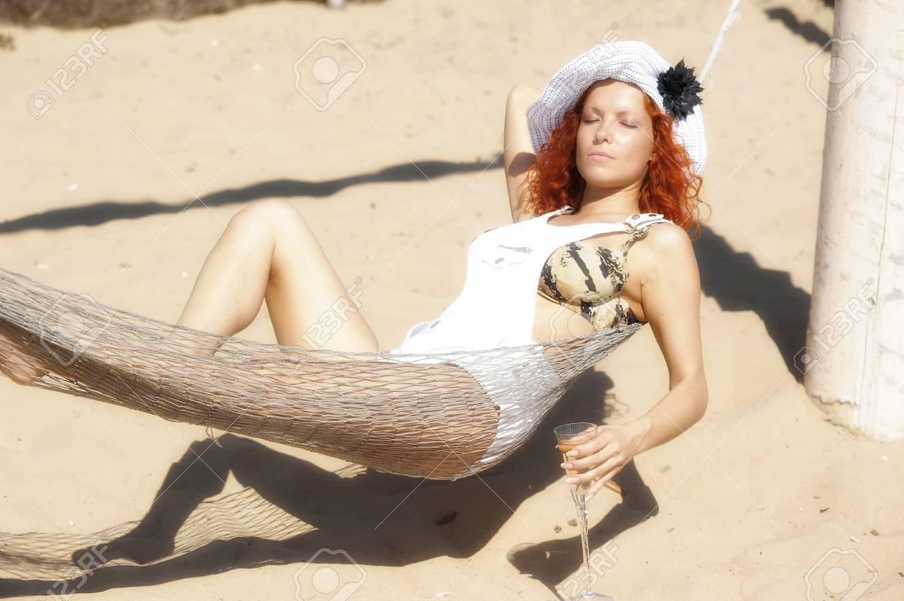 girl lying on the beach in a hammock Stock Photo - 11566632