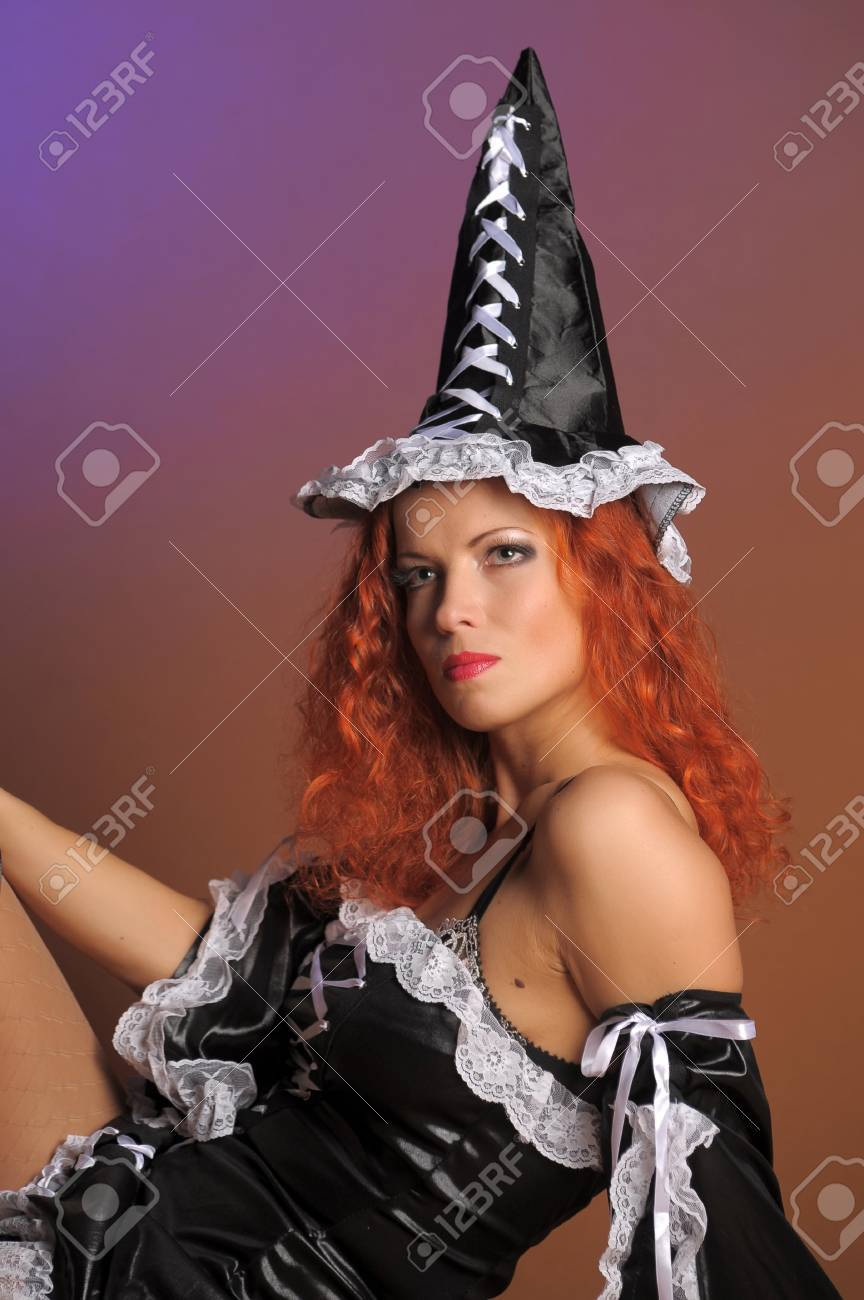 Sexy redheaded witch Stock Photo - 11422412