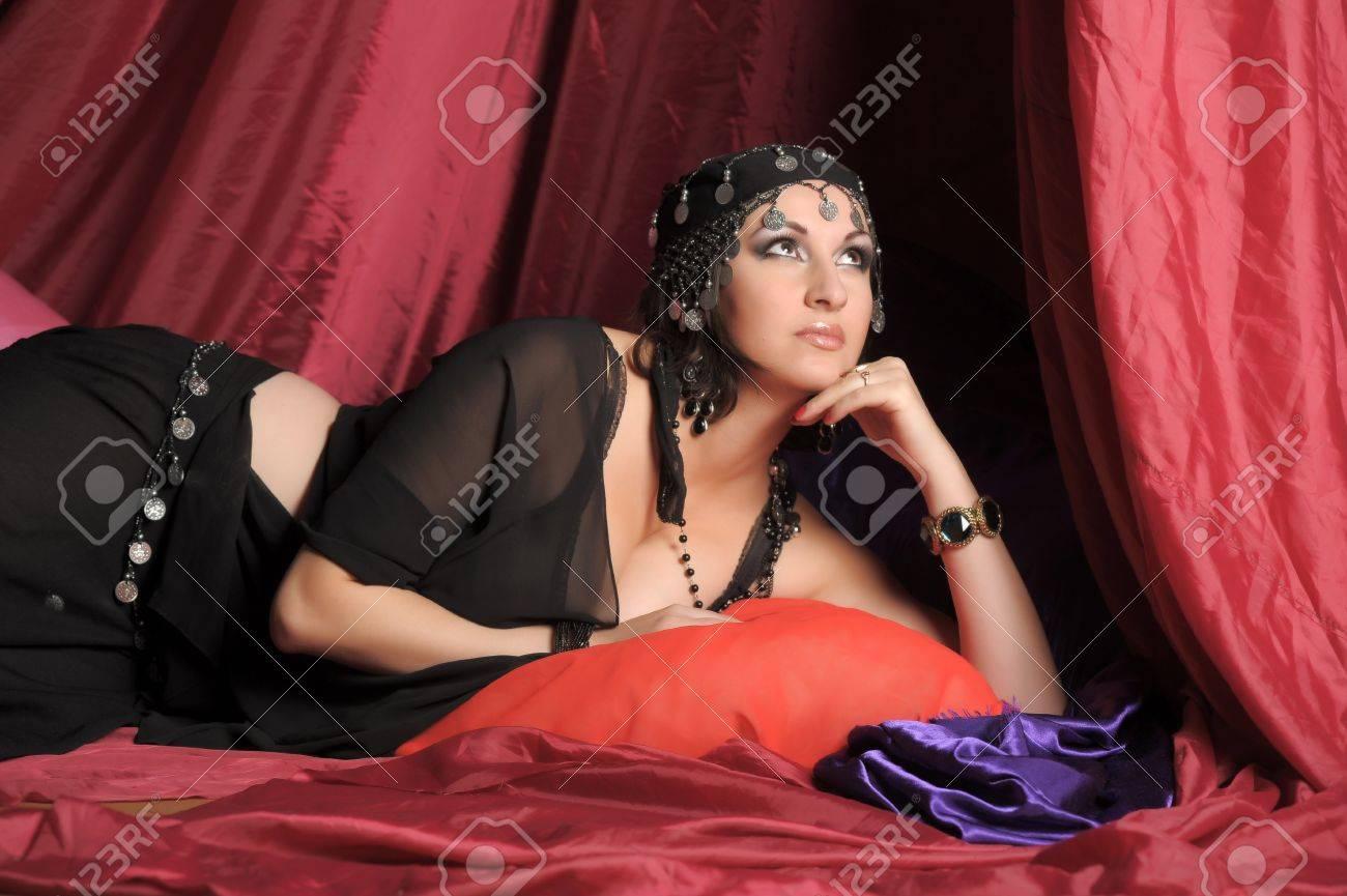 Beautiful Belly Dancer Lying Down Stock Photo - 11868890