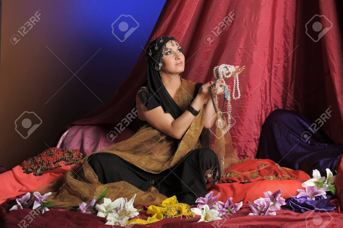 Shot of an oriental woman in a traditional costume Stock Photo - 11489565