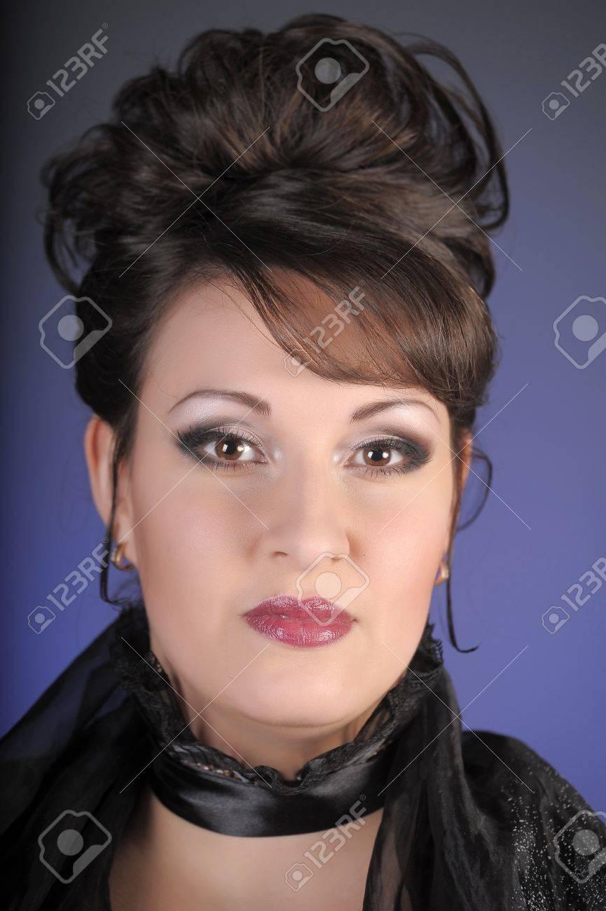 portrait of a beautiful brunette in a black dress Stock Photo - 15335890