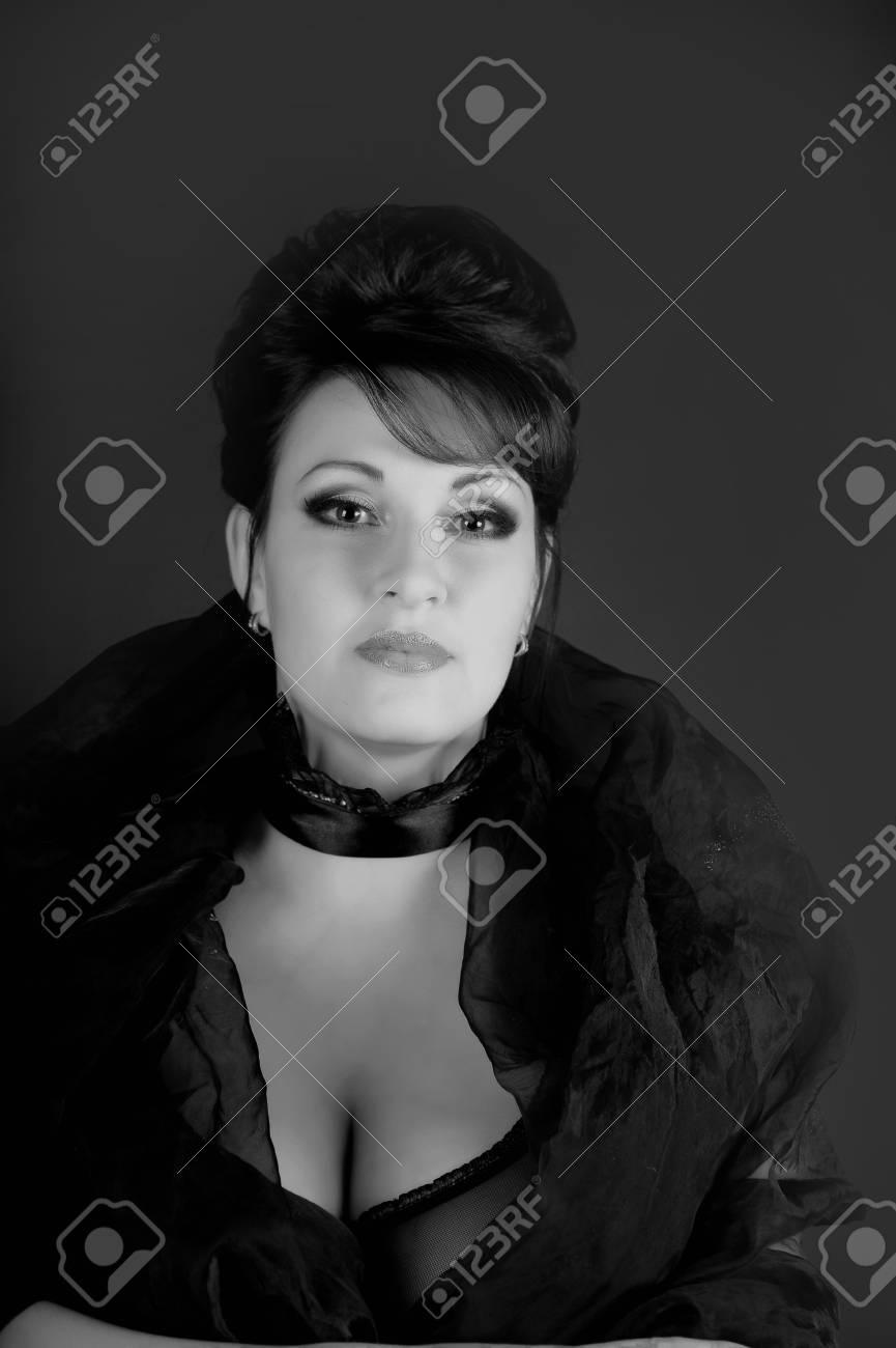 portrait of a beautiful brunette in a black dress Stock Photo - 15390943