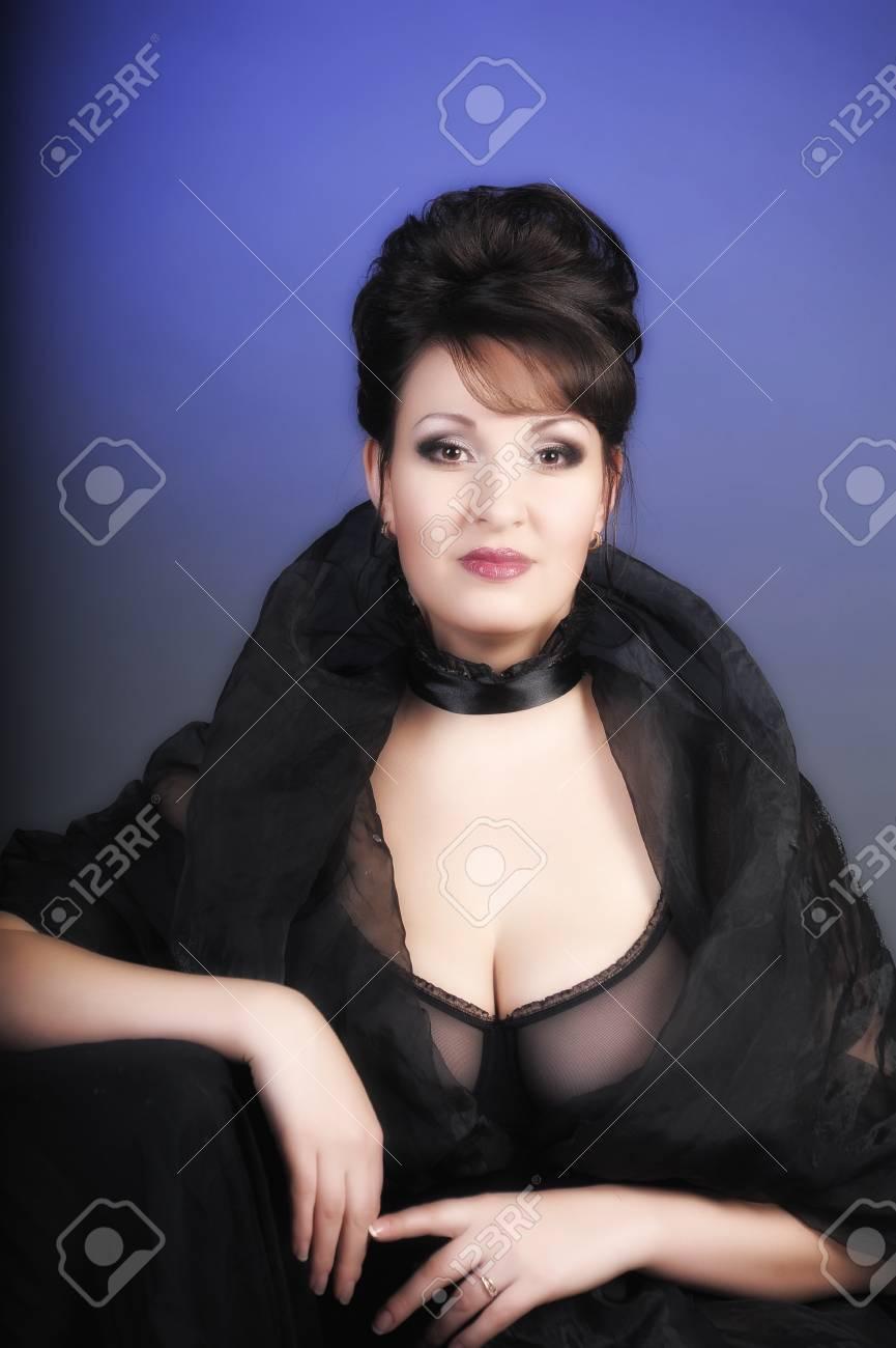 portrait of a beautiful brunette in a black dress Stock Photo - 15335864