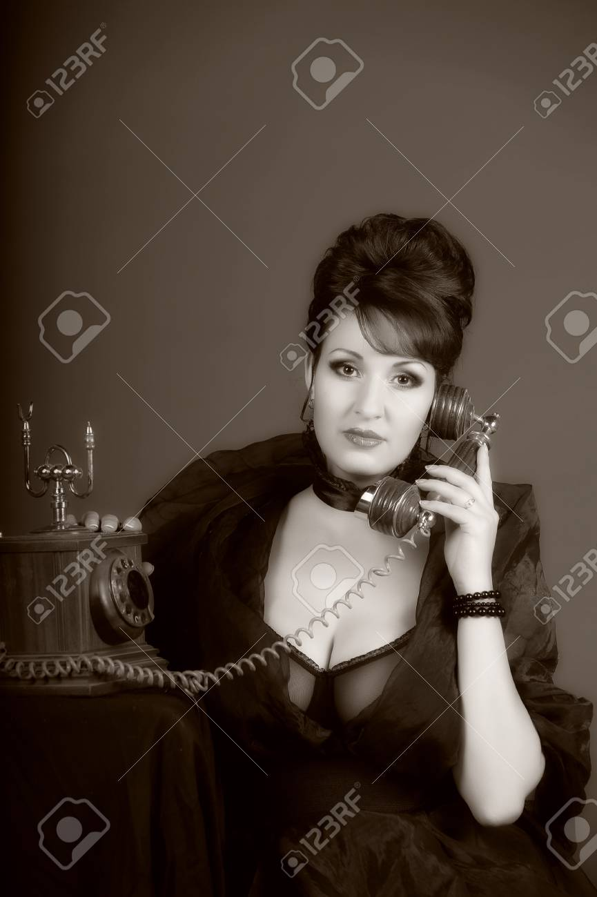The sexual woman speaking by phone. A vintage Stock Photo - 11954460