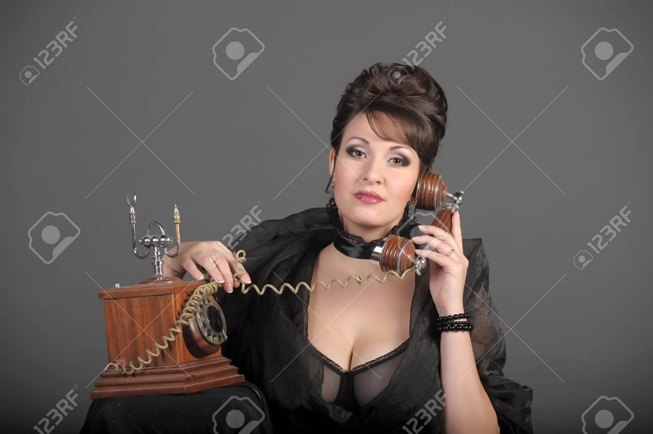 The sexual woman speaking by phone. A vintage Stock Photo - 11954474