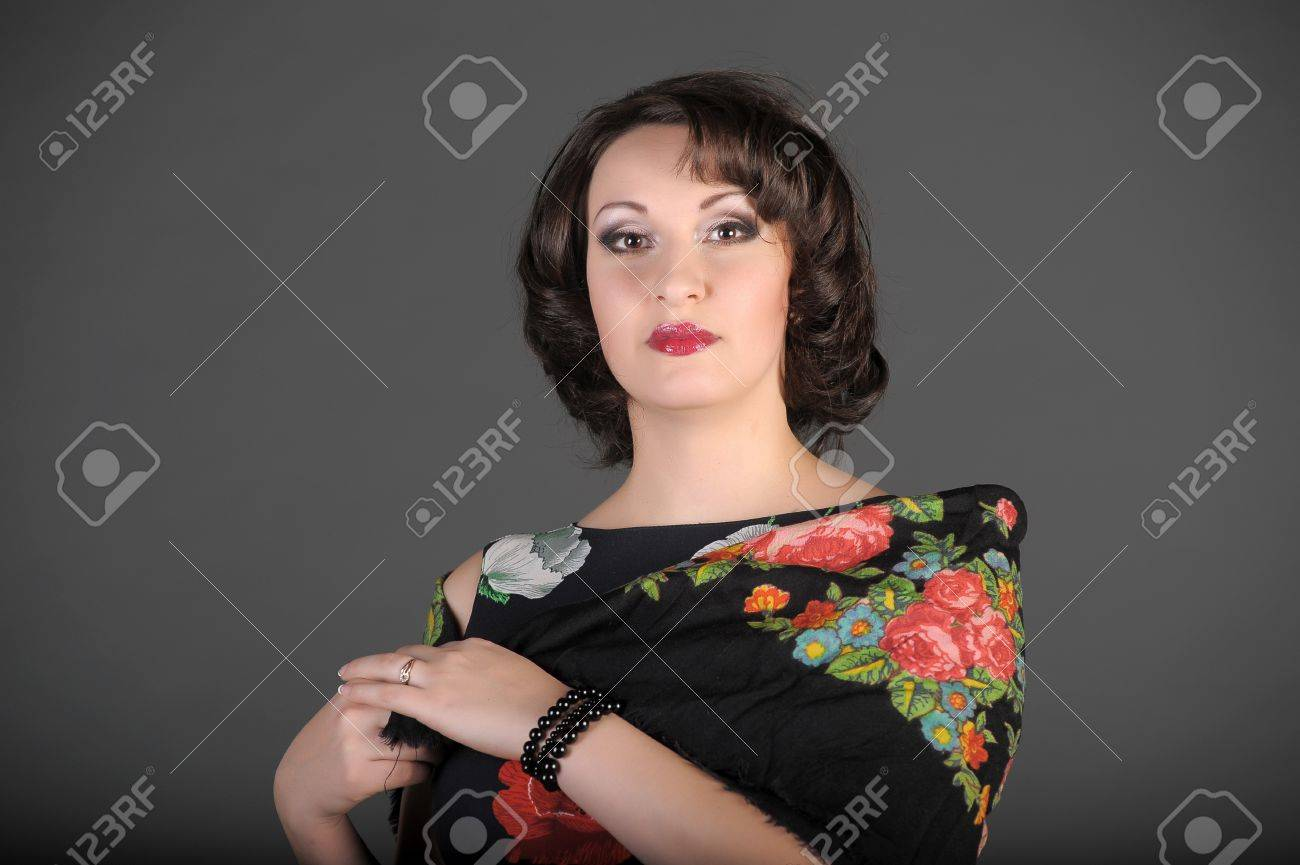 The beautiful Russian woman in a scarf on shoulders Stock Photo - 11954480