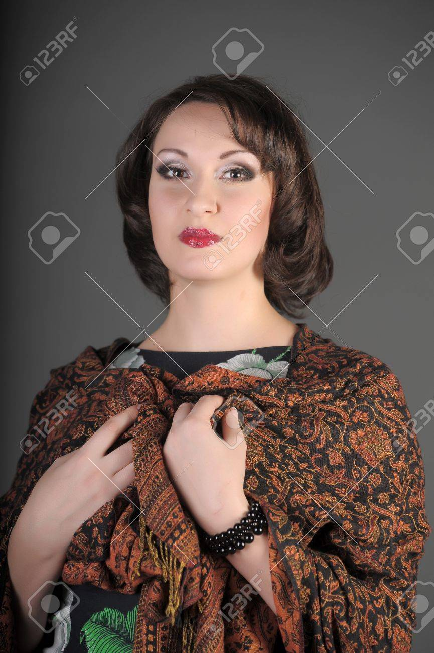 The beautiful Russian woman in a scarf on shoulders Stock Photo - 11954513
