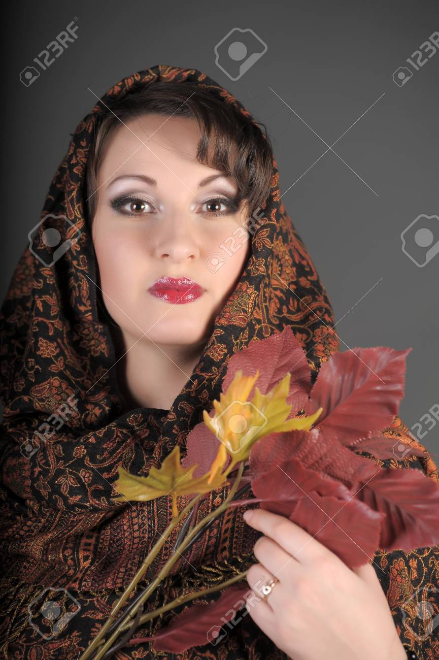The beautiful woman in a palatine with autumn leaves Stock Photo - 11953007