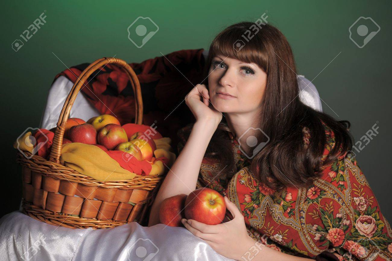 The young beautiful woman in Russian scarf with apples Stock Photo - 11961297