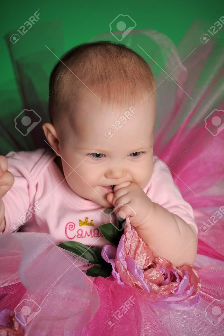 Little girl in a dress Stock Photo - 13571238