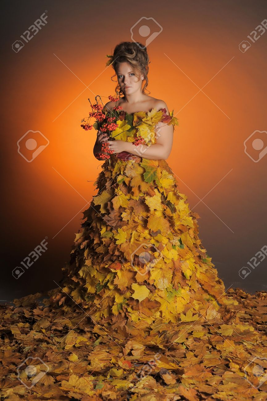 woman with a dress made of autumn leaves Stock Photo - 11422487