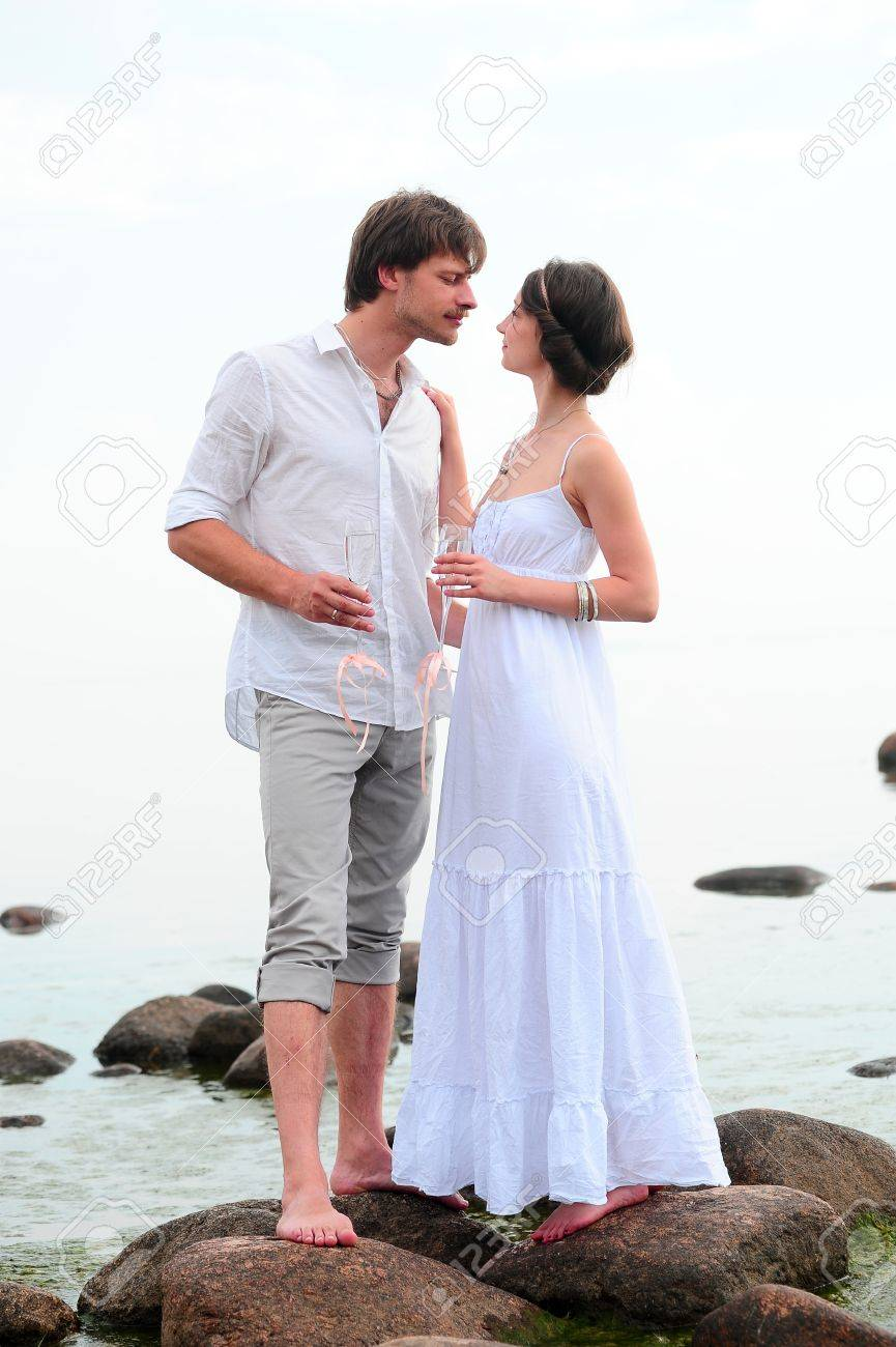 Young happy couple on the beach Stock Photo - 13501142