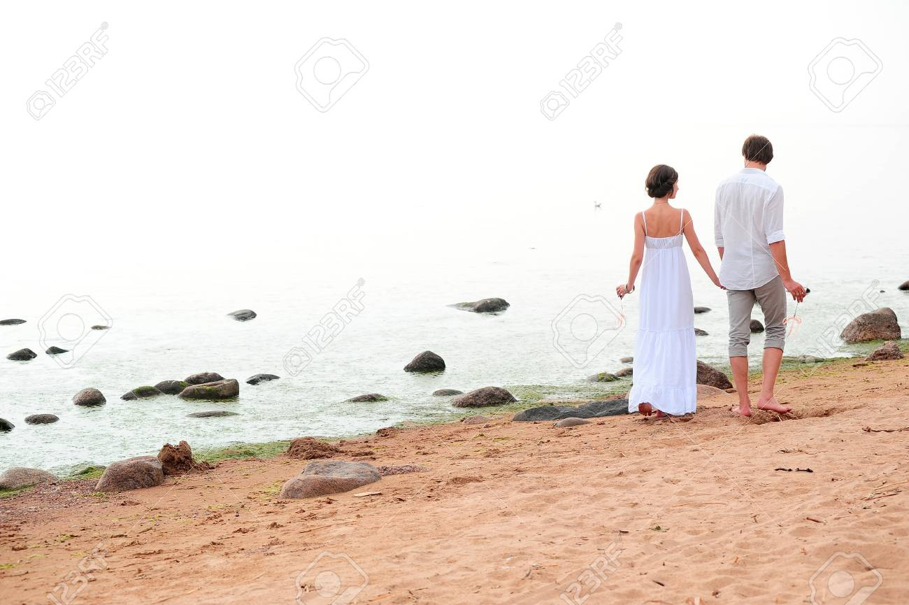 Young happy couple on the beach Stock Photo - 13501191