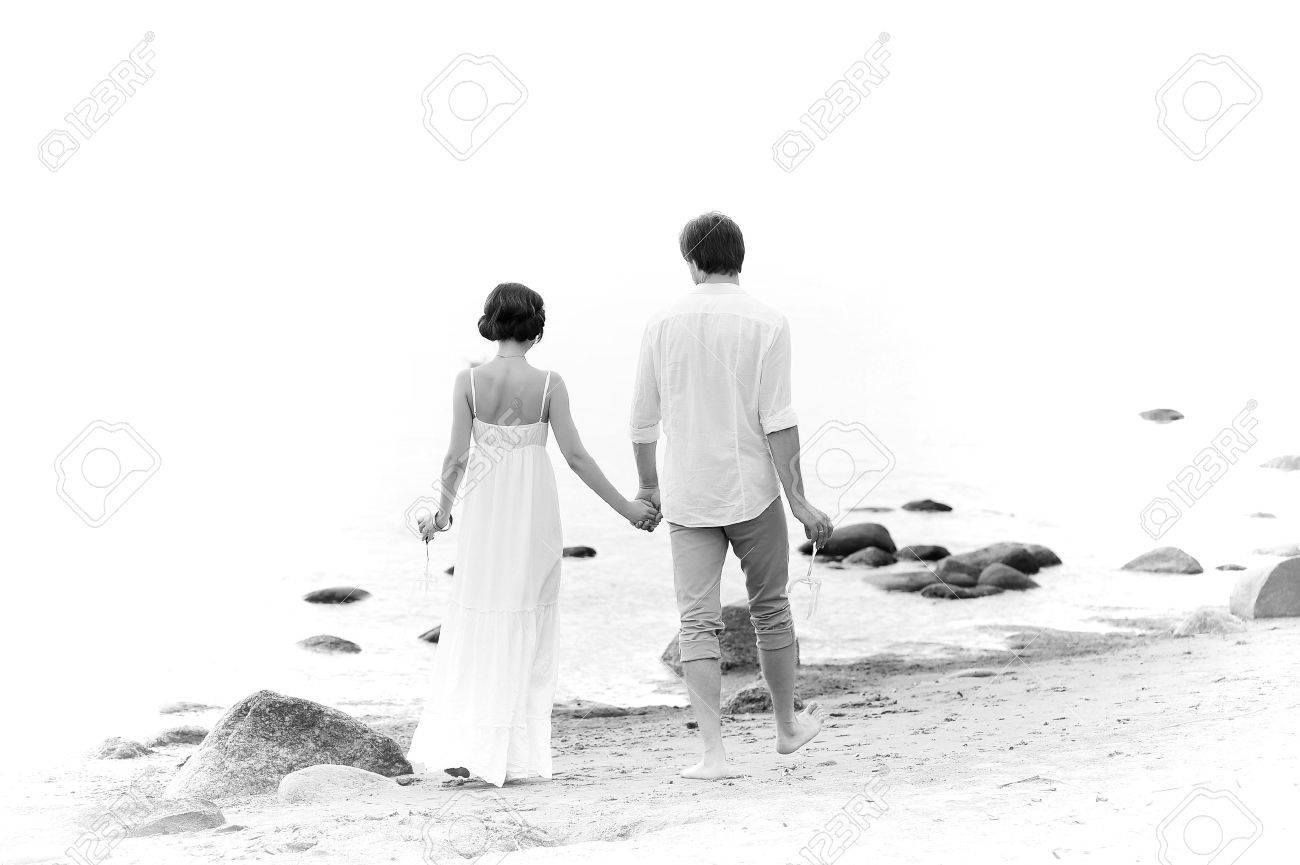 Young happy couple on the beach Stock Photo - 13501173