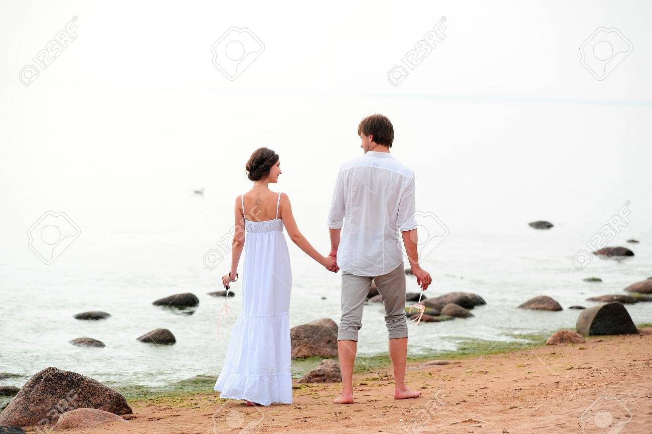 Young happy couple on the beach Stock Photo - 13501174