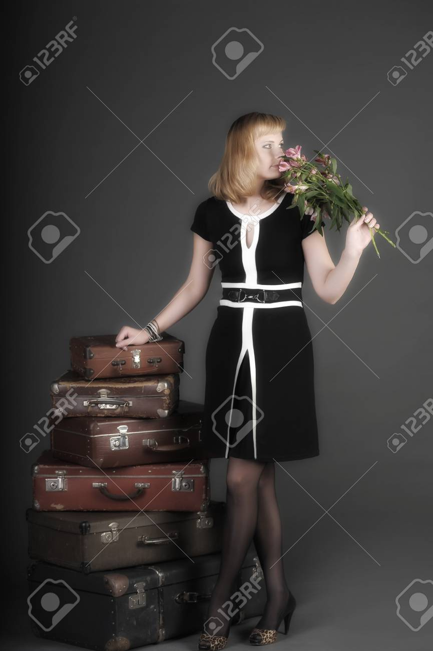 young woman and a lot of old suitcases Stock Photo - 11420738