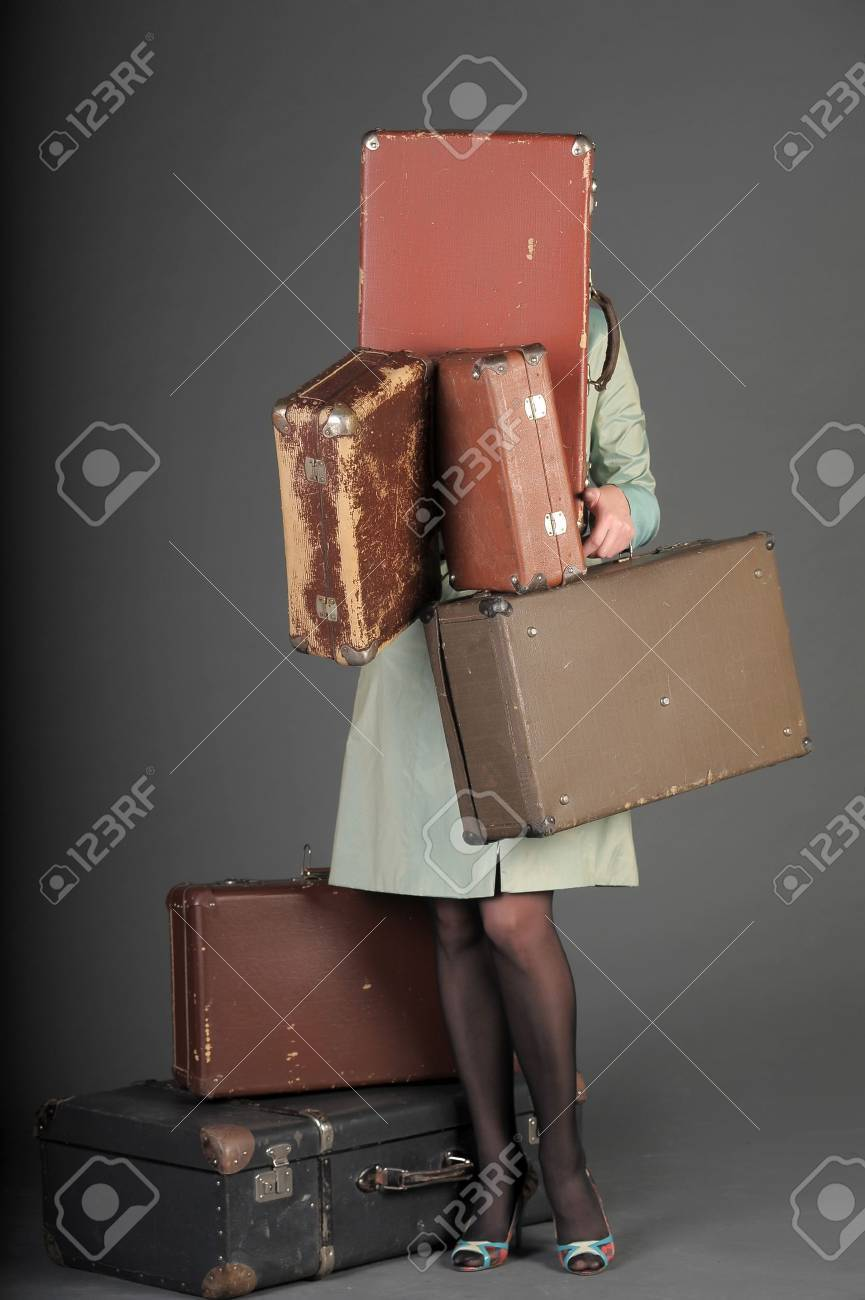 young woman and a lot of old suitcases Stock Photo - 11420798