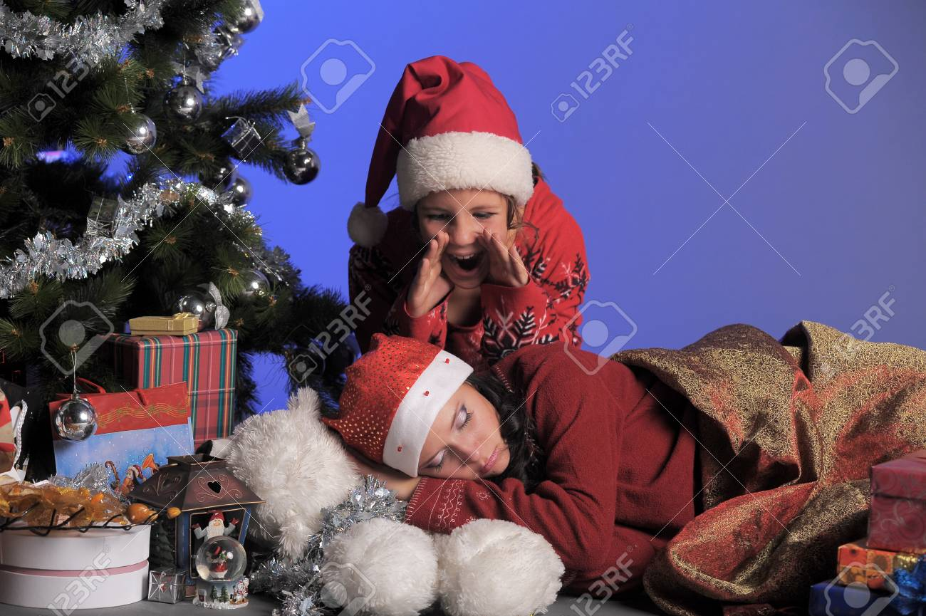 two girls of the teenager at a Christmas fir-tree Stock Photo - 13571893