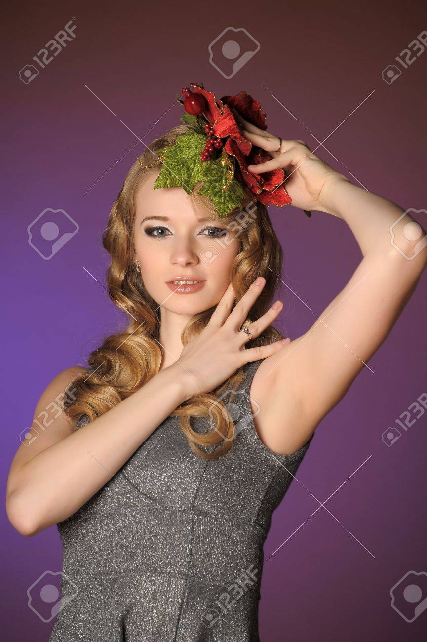 Vintage attractive blonde woman with a Christmas flower Stock Photo - 13572038