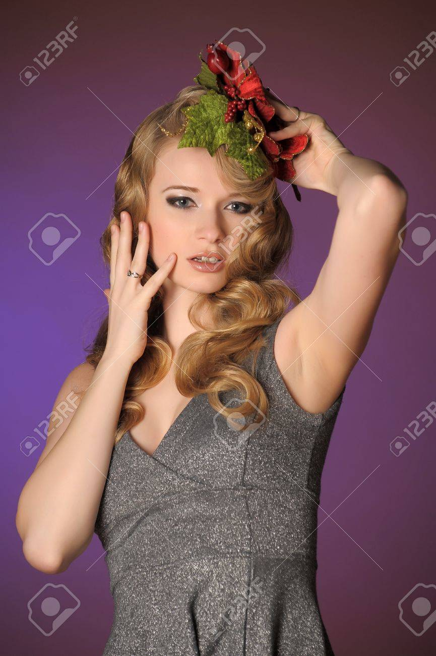 Vintage attractive blonde woman with a Christmas flower Stock Photo - 13572045