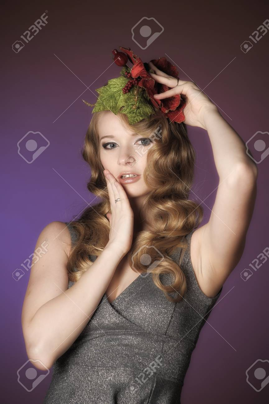 Vintage attractive blonde woman with a Christmas flower Stock Photo - 13572040