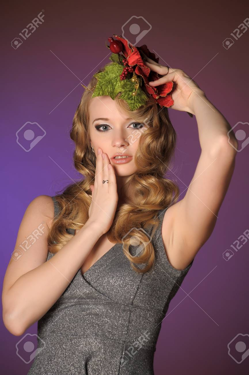 Vintage attractive blonde woman with a Christmas flower Stock Photo - 13572044