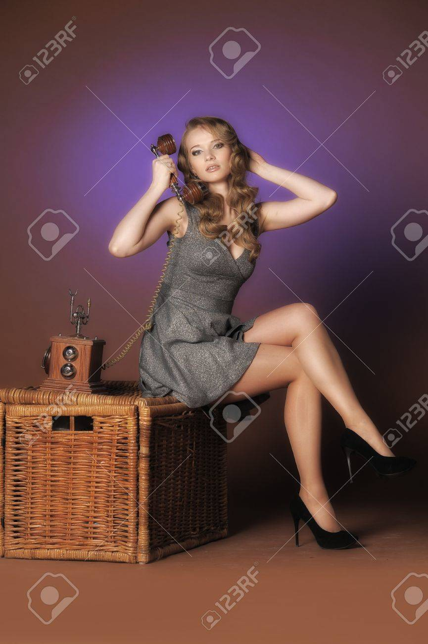 Sexy pinup girl talking on phone Stock Photo - 11422490