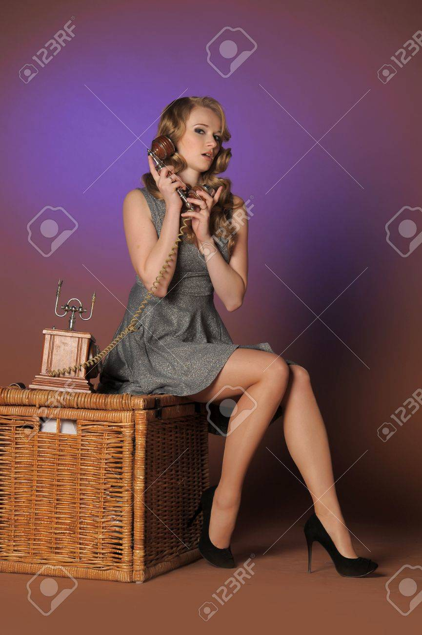 Sexy pinup girl talking on phone Stock Photo - 11422491